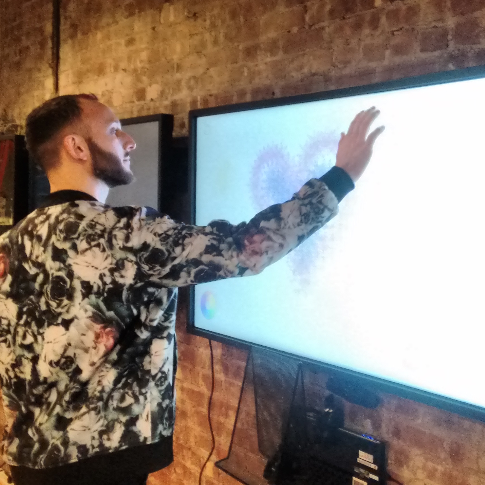 user interacting with project on a screen